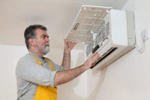 electrician examine or install air condition device in a room